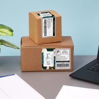 Shipping boxes with shipping labels and personalized labels