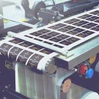 Custom printed roll labels being printed by Avery WePrint, the professional printing service offered by Avery